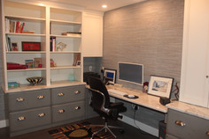 Office Cabinetry designed by Patty Heath, featuring distressed grey cabinets, and white open shelving with a quartz countertop.