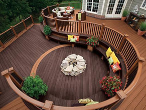 Image of Trex decking in a circular pattern with outdoor fireplace.