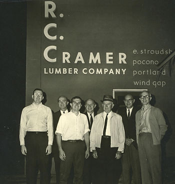 Image of R.C. Cramer and his sons in front of R.C. Cramer sign, circa 1953.