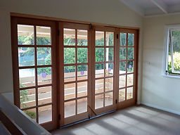 French doors opening onto balcony replacing old aluminium sliding doors.