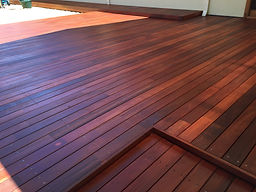 Multi level Jarrah timber decking installed and included jarrah wall feature panels.