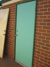 Garage door replaced with solid core secure door.