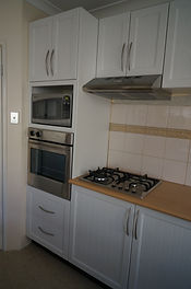 Kitchen renovation with new cabinet doors only.