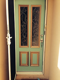 Solid feature entrance door with stained glass.