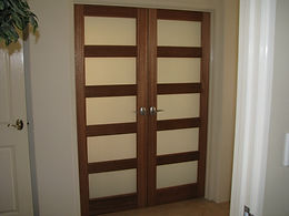 Opaque glass entry doors for home theatre room.