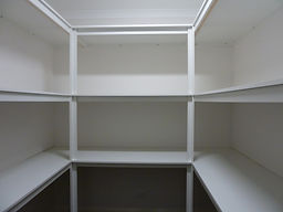 Storage shelving for linen cupboard or pantry.