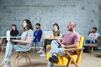 Students sitting at desks listening