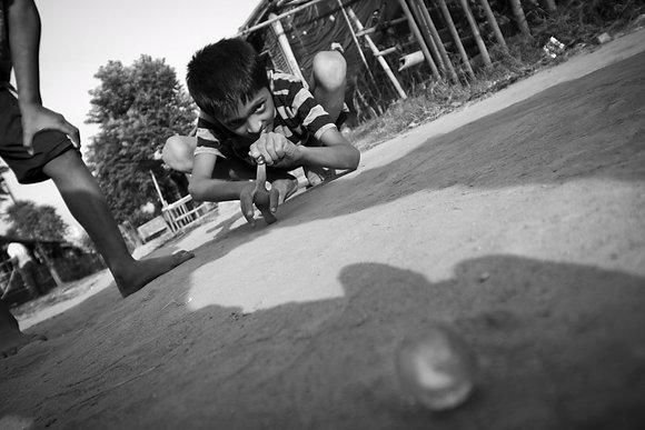 Playing Marbles by Kalpana Rai