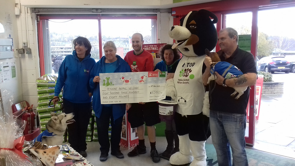 PAWS Trustees and Volunteers, Pets at Home Manager and Big Tod with Doris the dog