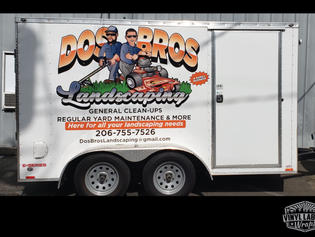 Custom full-color, wide format vinyl graphics wrap for the Dos Bros Landscaping of Monroe enclosed trailer by Vinyl Lab NW Signs and Graphics of Mukilteo
