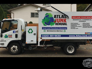 Atlas Junk Removal dump truck vinyl graphics - a logo and lettering kit by Vinyl Lab NW Signs and Graphics of Mukitleo. Addtional location in Gig Harbor.