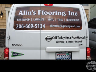 Alins flooring of Bothell and their Nissan NV200 vehicle sign graphics designed and installed by Vinyl Lab NW Signs and Graphics of Mukitleo. Addtional location in Gig Harbor.