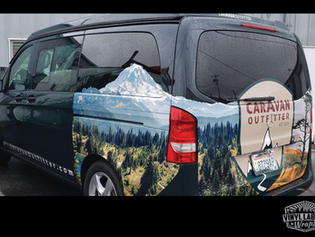 Campbell Auto Group's custom Caravan Outfitter vans exude utility and style - partial vinyl vehicle wrap by Vinyl Lab NW Signs and Graphics of Mukilteo