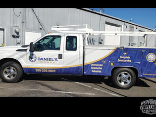 Truck advertising half wrap for Daniel's Doors of Lake Stevens by Vinyl Lab NW Signs and Graphics of Mukilteo