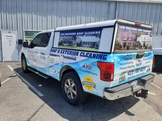 Blue Skies roof and exterior cleaning partial truck vinyl wrap - advertising one wheels. Great ROI and innovative marketing by Vinyl Lab NW Signs and Graphics of Mukitleo. Addtional location in Gig Harbor.