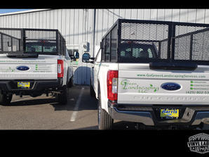 Green Landscaping fleet of truck vinyl graphics and lettering by vinyl lab wraps of mukilt