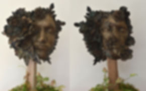 Bronze cast (two sides) with patina on wooden stand