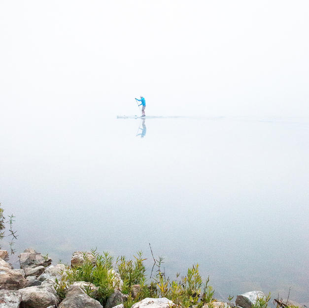 Paddleboarding on the Lake in the Fog