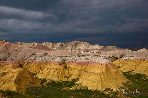 View of the badlands with a dark sky in the background