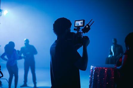 contour of a man with a film camera