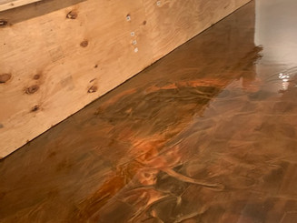 Metallic pigment epoxy basement flooring.