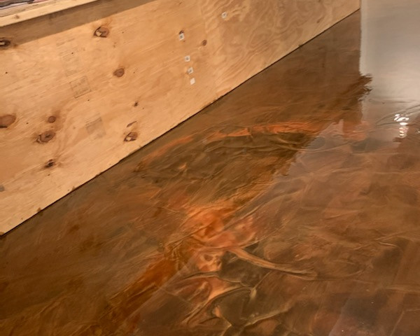 Metallic pigment epoxy basement flooring.