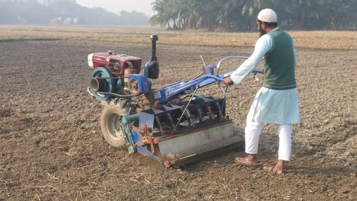Operation of the power tiller operated seeder in Bangladesh