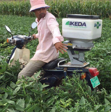 A seed broadcaster being used in Cambodia