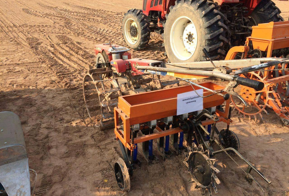 Demonstration of a tractor powered drill in Cambodia