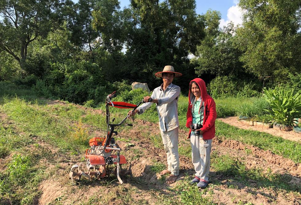 Cambodian farmer with a power tiller