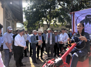 The Minister of Agriculture, Forestry and Fisheries, Veng Sakhon; and US Ambassador in Cambodia Patrick Murphy with Horace Clemmons, CEO of Cleber, a private company promoting Open Systems Agricultural Machinery like the Oggun tractor driven by a Cambodian agricultural engineering intern.