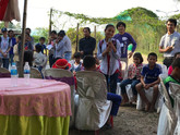 A Rasmey Sophanna High School student at the CE SAIN Technology Park in Cambodia answers questions about her groups  conservation agriculture garden