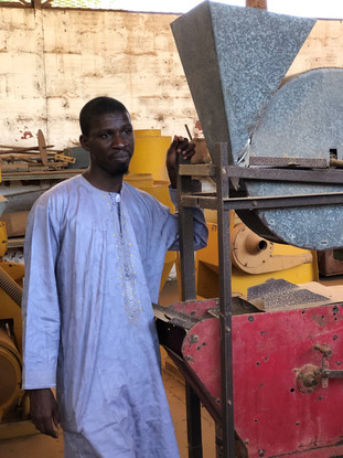 Dr. Demba DIAKHATE discusses agricultural mechanization with some members of the ASMC team at the National Agronomic Research Center in Bambey, Senegal
