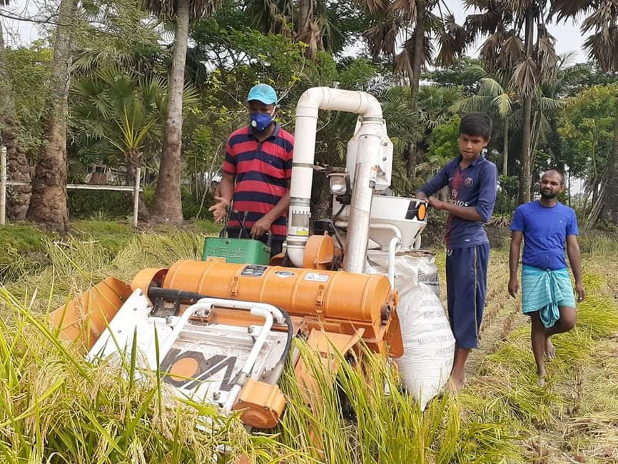 The mini-combine harvester being used in Bangladesh