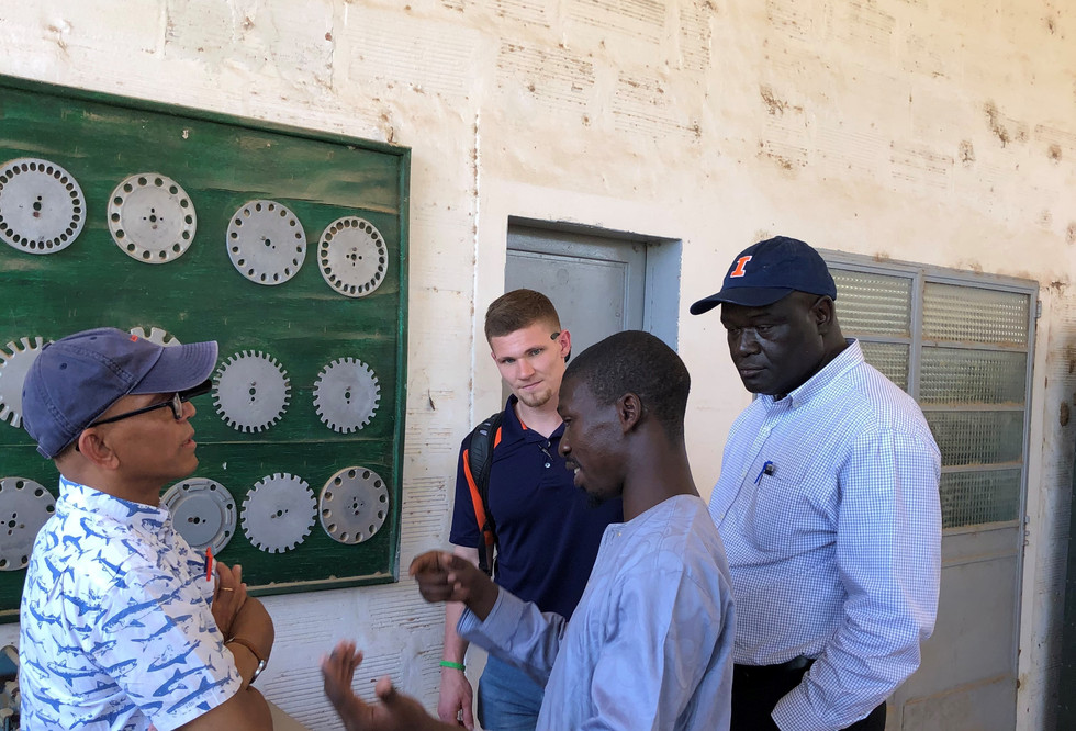 Dr. Demba DIAKHATE discusses agricultural mechanization with some mebers of the ASMC team at the National Agronomic Research Center in Bambey, Senegal