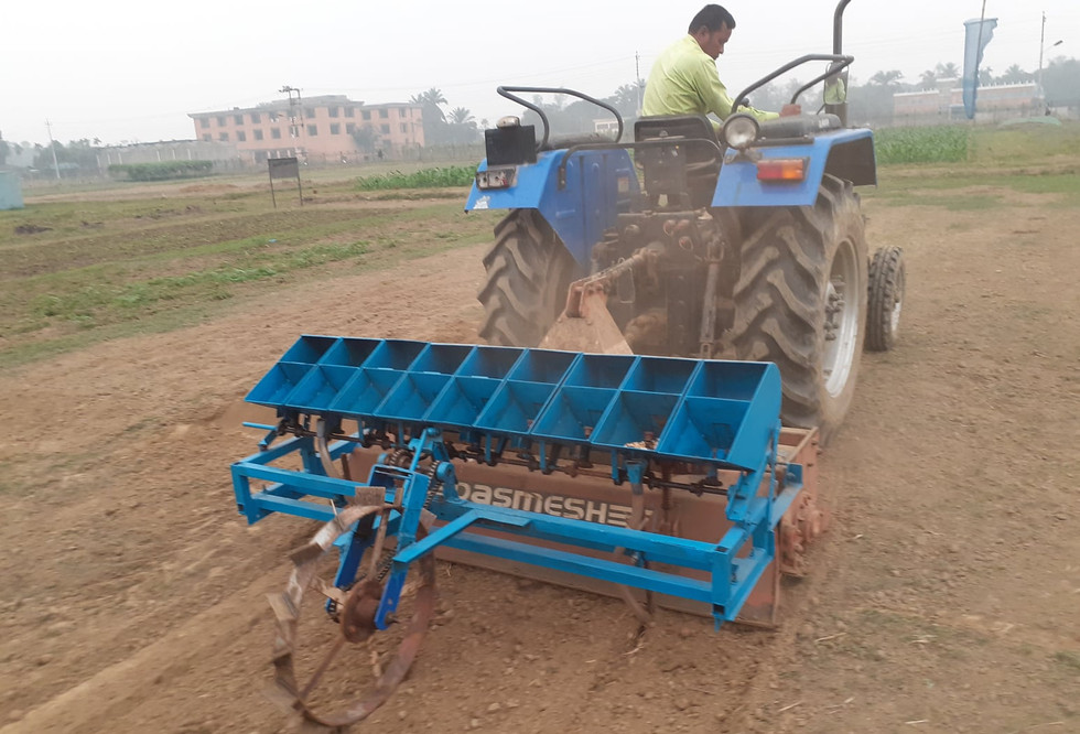 Testing of the 4-wheel tractor based seeder at the Conservation Agriculture Park at Bangladesh Agricultural Research Institute (BARI) in Gazipur, Bangladesh