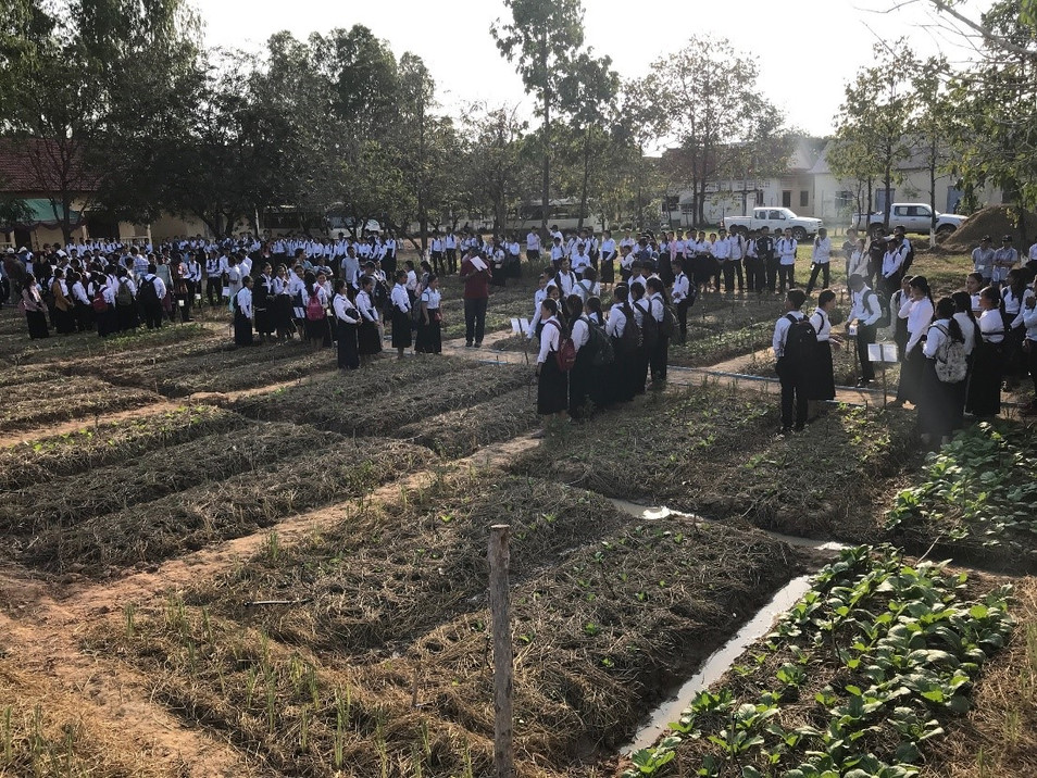 Rasmey Sophanna High School students at the CE SAIN Technology Park in Cambodia present their conservation agriculture gardens to judges for a student competition