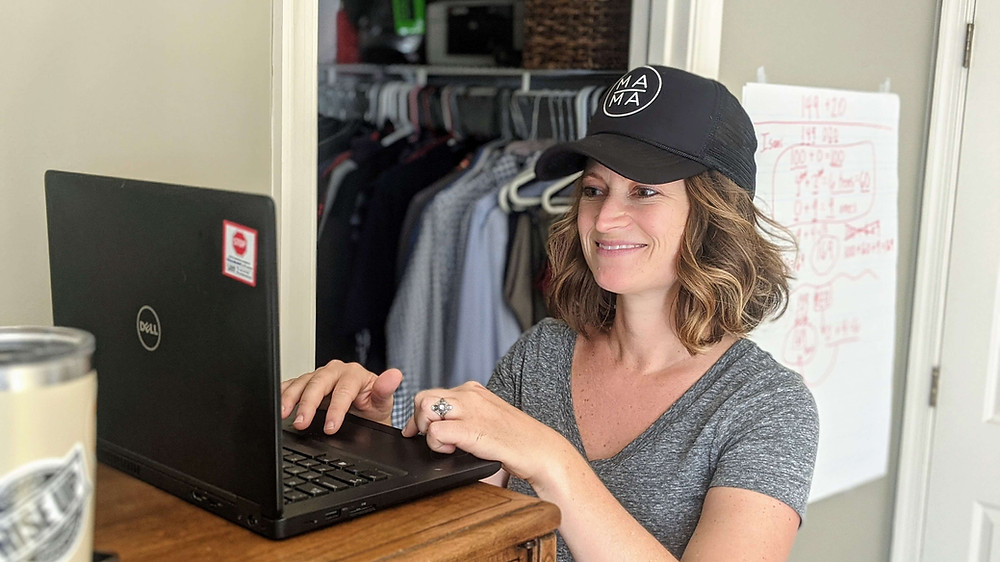 A third grade teacher distance learning from her bedroom