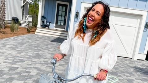 Amanda Reeder on a bike in her driveway