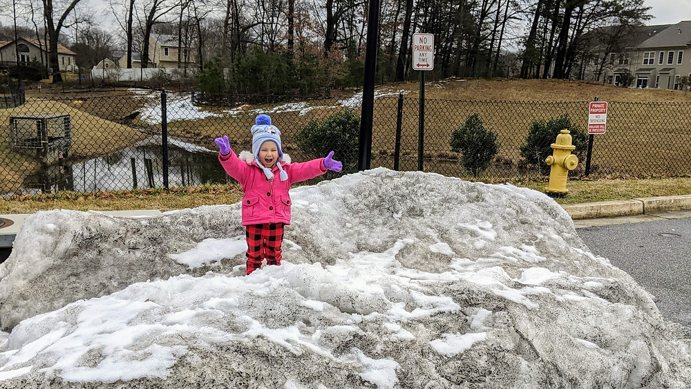 Toddler at the top of snow mountain