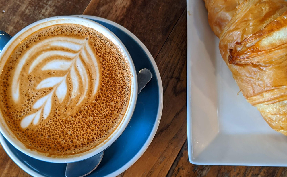 Croissant with an artsy latte