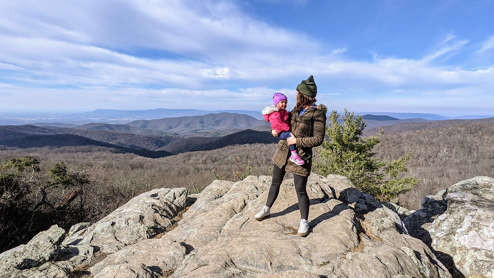 Mother holding toddler overlooking the Shenandoah Mountains on Skyline Drive