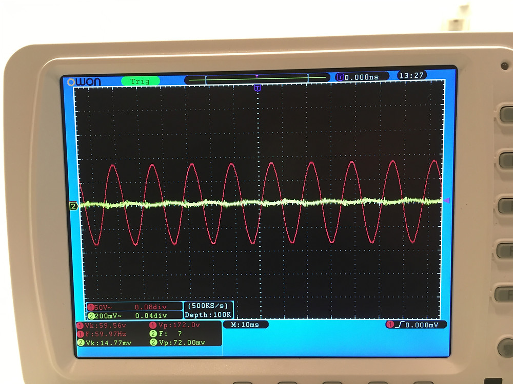 oscilloscope scan of 60hz sine wave (red) and dirty electricity (yellow)