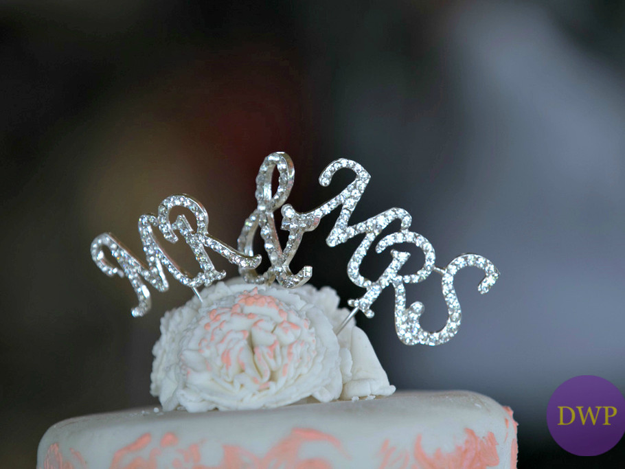 Mr & Mrs silver cake topper.