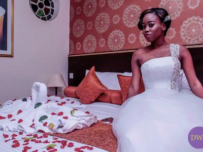 Bride on honeymoon bed.