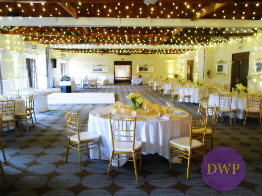 Indoor wedding reception with fairy lights.
