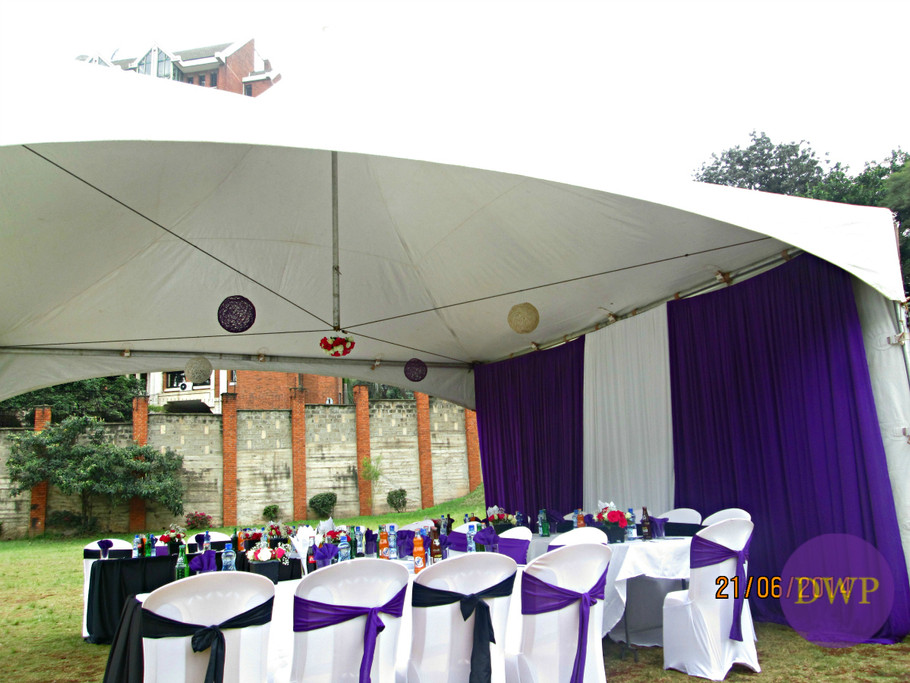 Purple and black wedding reception high table.