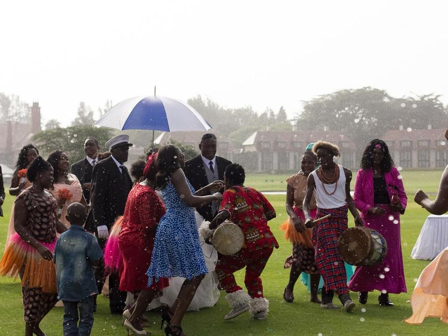 Bride and groom wedding reception entry in the rain.