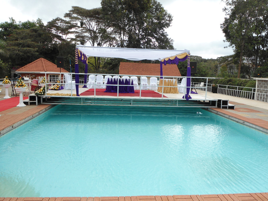 Wedding ceremony stage ontop of swimming pool.
