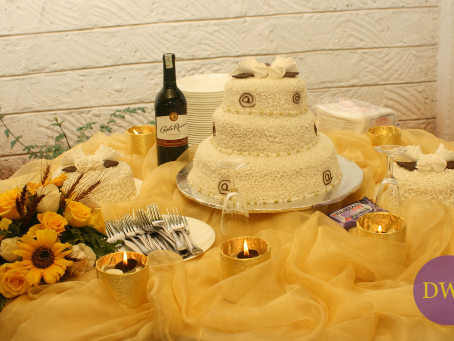 Warm yellow and gold cake table setting.